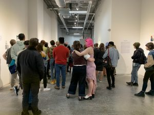 A group of people gathered together at the exhibit