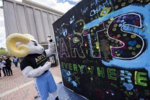 Ramses painting on an Arts Everywhere sign