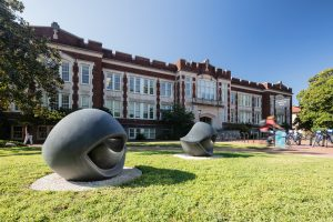 Two granite benches sculpted into the shape of eyes in front of Phillips Hall at UNC