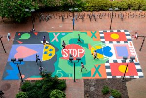 A basketball court with colorful designs and signage