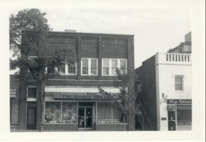 Black and white storefront, brick building