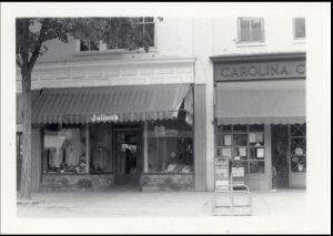 black and white image of Julian's storefront