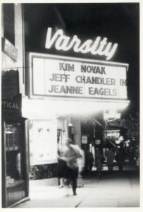 """The Varsity Theater marquee. It reads """"Kim Novack,"""" """"Jeff Chandler In,"""" and """"Jeanne Eagels."""""""