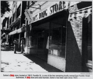 Black and white image of the storefront.