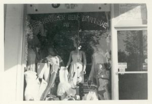 black and white image of the Shrunken Head display window that has three manequins