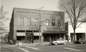 black and white; a brick building with Spanky's on the left (corner of the block) and The Hub on the right