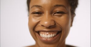 Closeup of AhDream Smith with a large smile